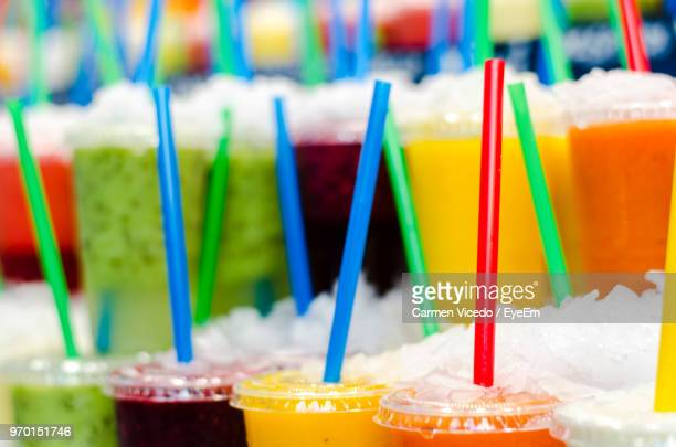Close-Up Of Various Slush For Sale At Market