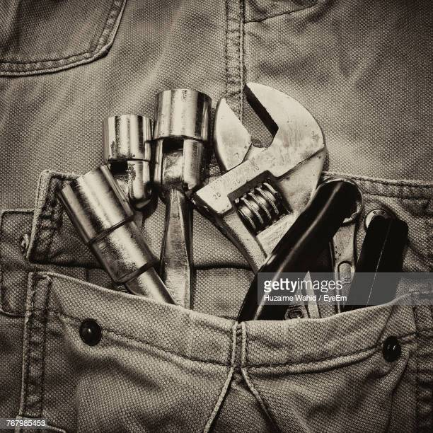 Close-Up Of Various Work Tools In Pocket