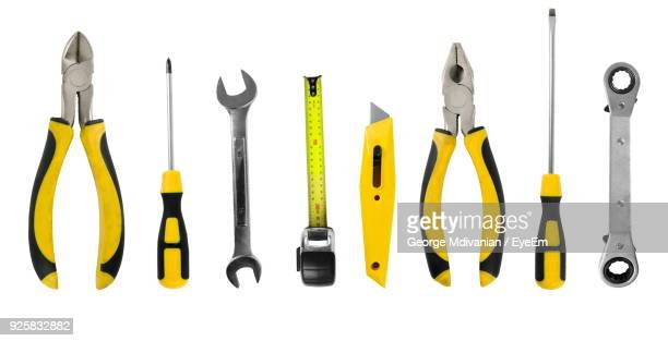 close-up of various work tools over white background - screwdriver stock pictures, royalty-free photos & images