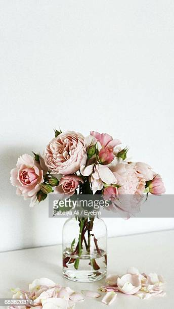 Close-Up Of Vase Of Roses