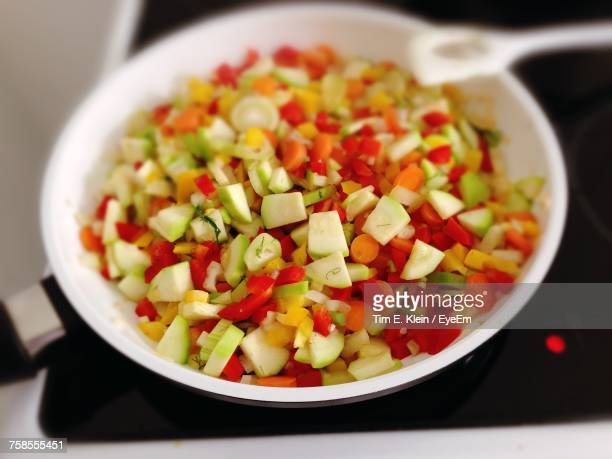 close-up of vegetable in pan on electric stove burner - klein stock pictures, royalty-free photos & images
