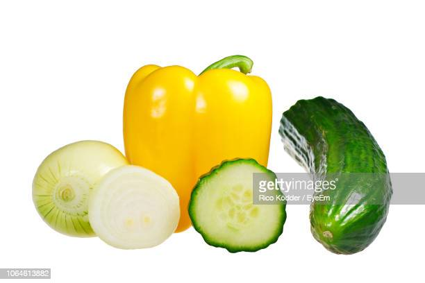 close-up of vegetables against white background - yellow bell pepper stock pictures, royalty-free photos & images