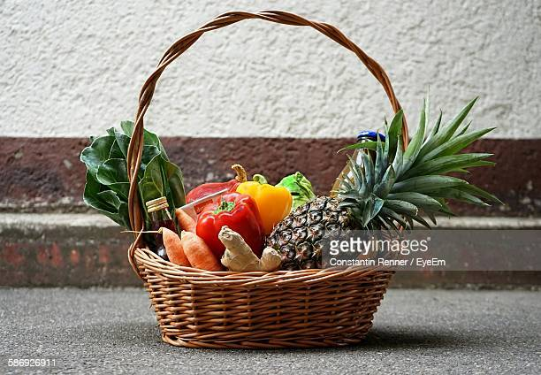 Close-Up Of Vegetables And Fruits In Wicker Basket
