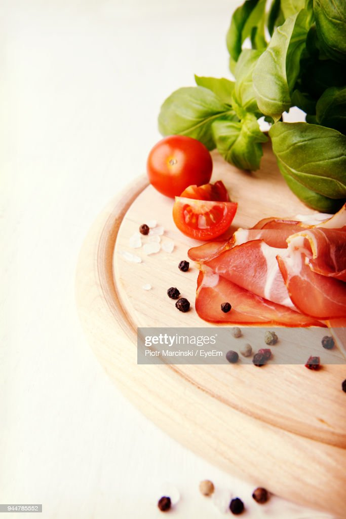 Close-Up Of Vegetables And Meat On Cutting Board : Stock Photo