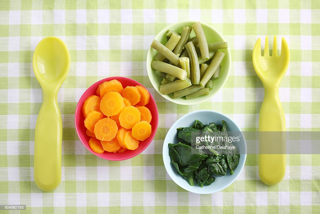 Close-up of vegetables in baby bowls : Stock Photo
