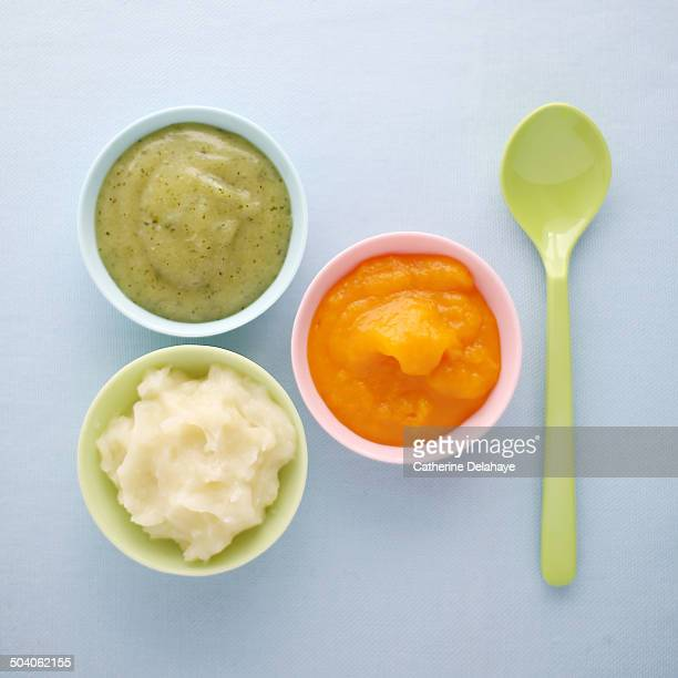 Close-up of vegetables mashes in baby bowls