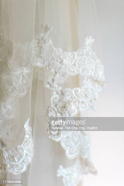 close-up of veil against white background - lace textile stock pictures, royalty-free photos & images