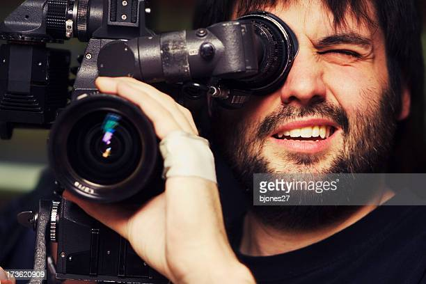 close-up of videographer filming with bandage on hand - cinematographer stock pictures, royalty-free photos & images