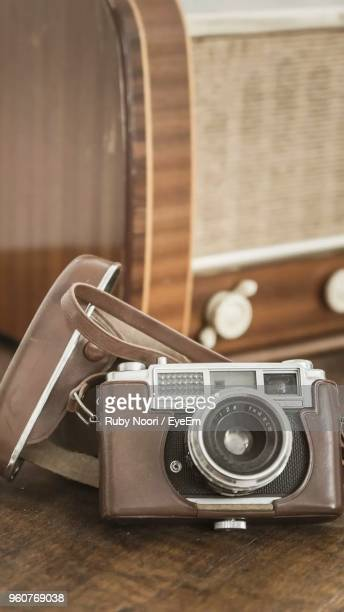 Close-Up Of Vintage Camera On Table