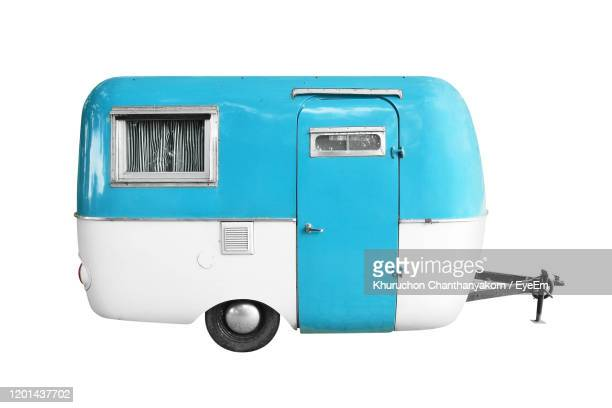 close-up of vintage camper trailer against white background - camper trailer stock pictures, royalty-free photos & images