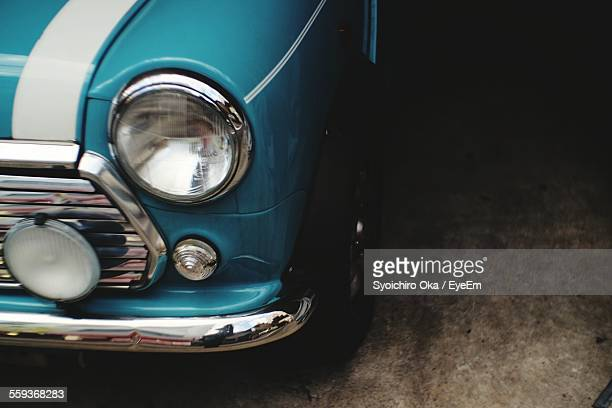 Close-Up Of Vintage Car Headlight And Chrome Bumper