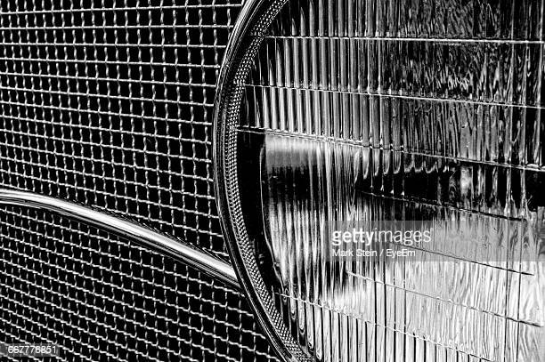 close-up of vintage car headlight - grille stock photos and pictures
