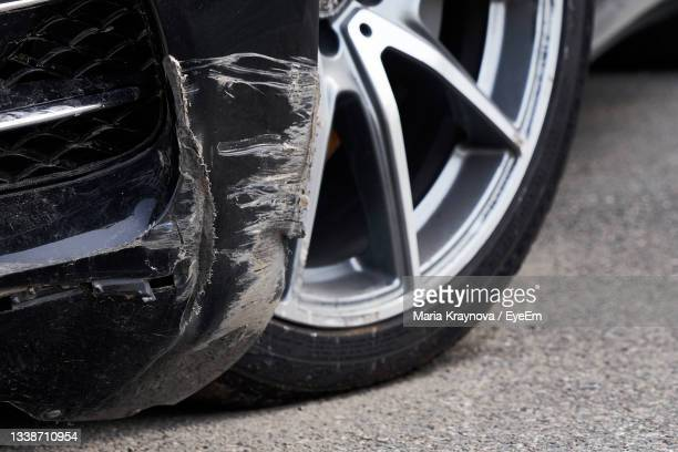 close-up of vintage car on road - damaged stock pictures, royalty-free photos & images