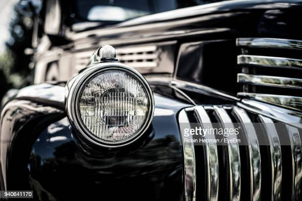 close-up of vintage car - vehicle grille stock pictures, royalty-free photos & images