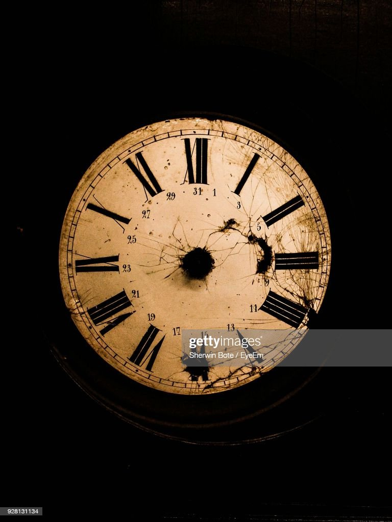 Close-Up Of Vintage Clock Against Black Background : Stock Photo