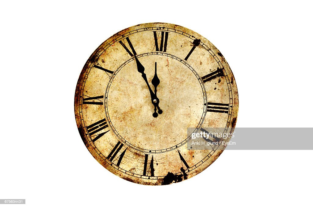 Close-Up Of Vintage Clock Against White Background : Stock Photo