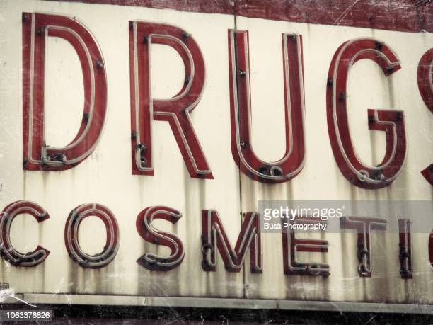 closeup of vintage drugstore cosmetics sign in manhattan, new york city - east village stock pictures, royalty-free photos & images