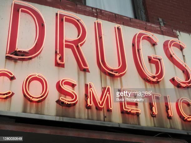 closeup of vintage drugstore cosmetics sign in the east village in manhattan, new york city - east village stock-fotos und bilder