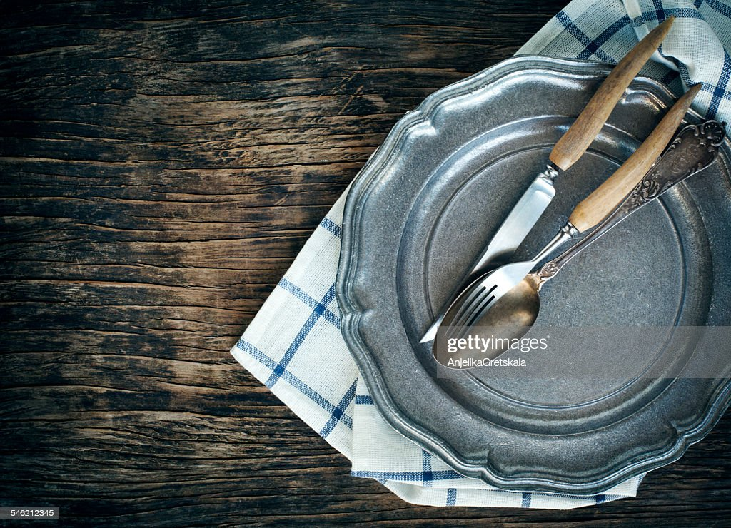 Close-up of vintage plate with fork, spoon and table knife : Stock Photo