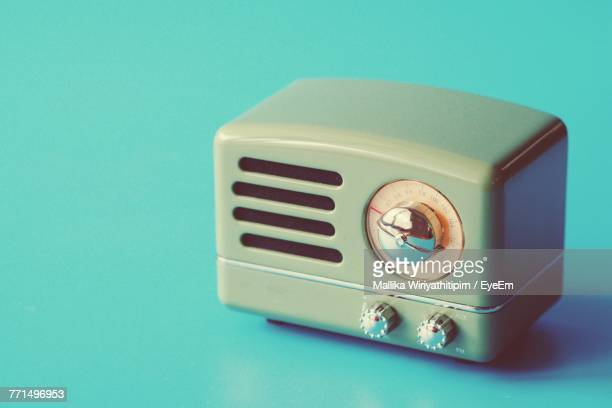 Close-Up Of Vintage Radio Against Blue Background