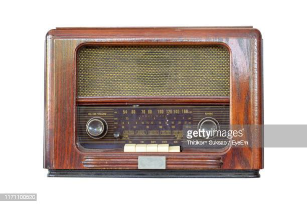 close-up of vintage radio against white background - radio stock pictures, royalty-free photos & images