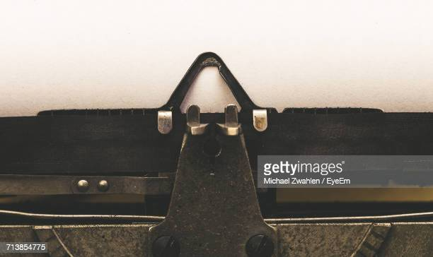 Close-Up Of Vintage Typewriter With Blank Paper
