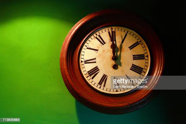 close-up of vintage wall clock - wall clock stock photos and pictures