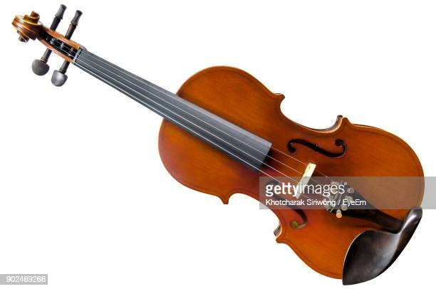 close-up of violin against white background - violin stock pictures, royalty-free photos & images