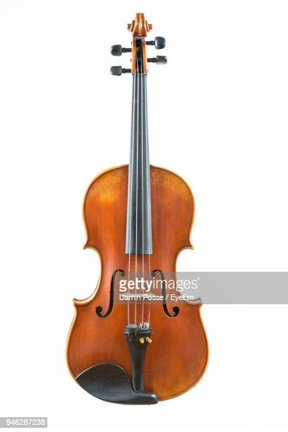close-up of violin against white background - 楽器 ストックフォトと画像