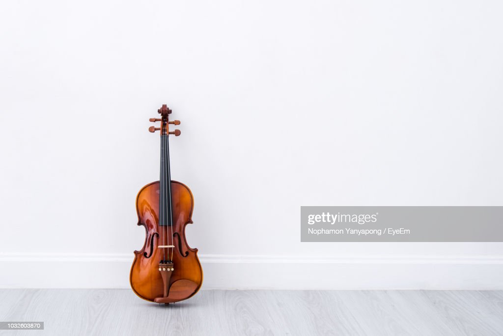 Close-Up Of Violin Against White Wall : Stock Photo