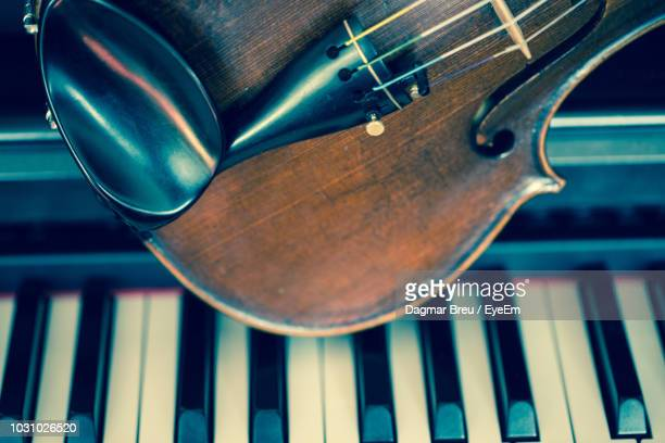 close-up of violin on piano keys - classical music stock pictures, royalty-free photos & images
