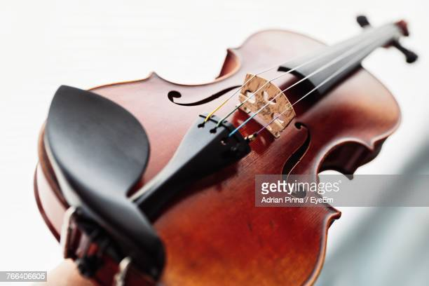 Close-Up Of Violin Over White Table