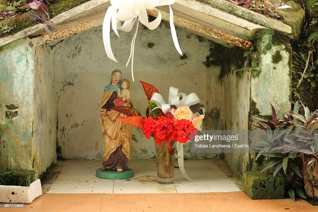 Closeup Of Virgin Mary And Christ By Flower Vase In Niche ... on us metalcraft vases, niche flower holders, cemetery vases, floral vases, niche wall art, graveside vases, bud vases,