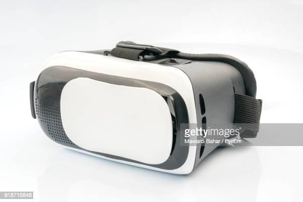 close-up of virtual reality simulator against white background - virtual reality simulator stock photos and pictures