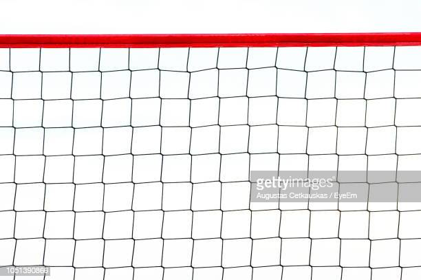 Close-Up Of Volleyball Net Against White Background