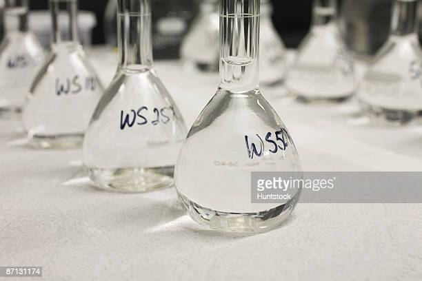close-up of volumetric flasks in a row  - volume fluid capacity stock pictures, royalty-free photos & images