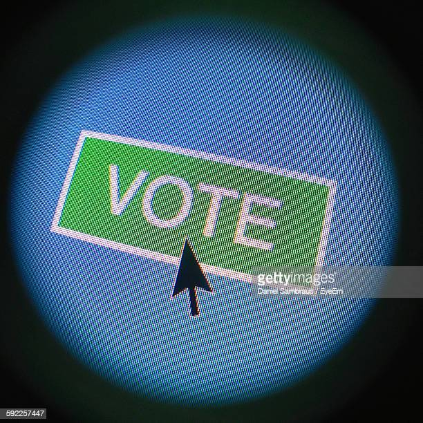 Close-Up Of Vote Sign On Computer Monitor