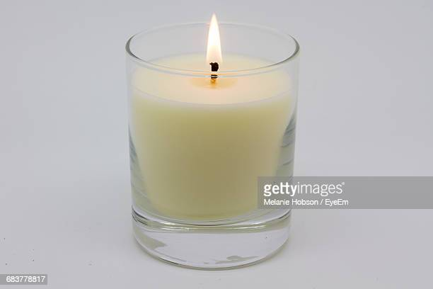 close-up of votive candle - cero foto e immagini stock