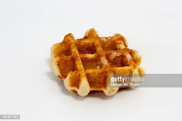 close-up of waffle against white background - waffle stock photos and pictures