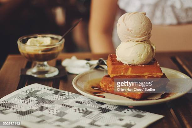 Close-Up Of Waffle Ice Cream Stack Served In Plate