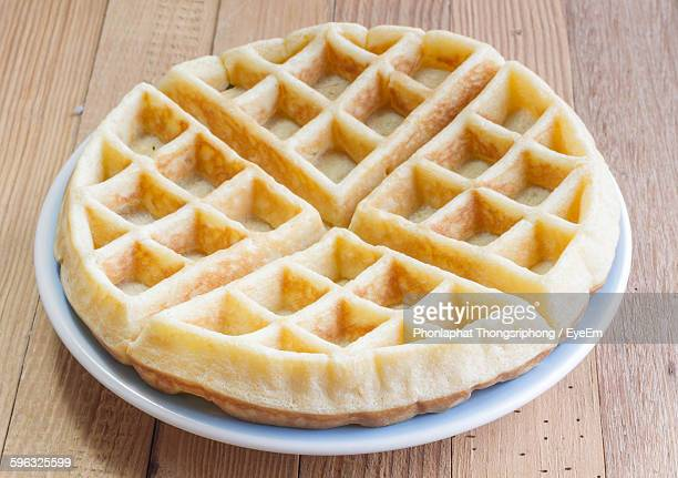 close-up of waffle served on table - waffle stock photos and pictures
