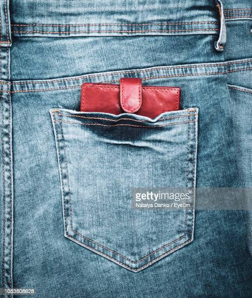 Close-Up Of Wallet In Jeans Pocket