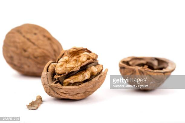 close-up of walnut against white background - nutshell stock photos and pictures