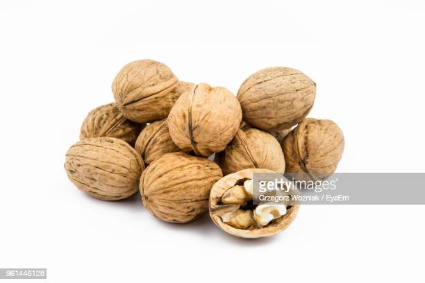 Close-Up Of Walnuts Against White Background