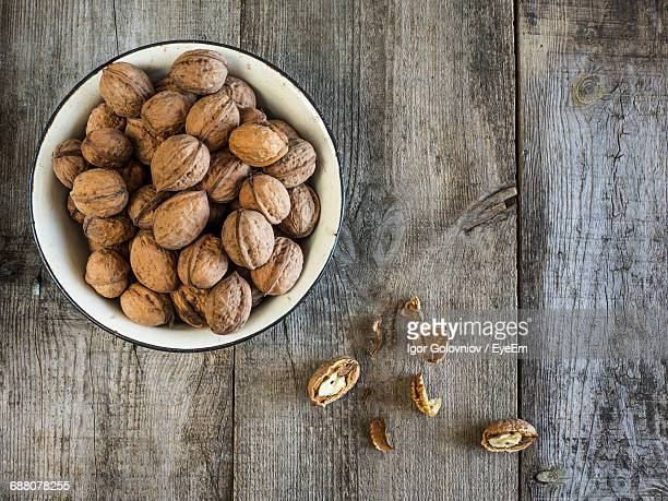 close-up of walnuts in bowl - nutshell stock photos and pictures