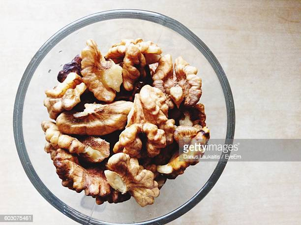 Close-Up Of Walnuts In Glass Bowl On Table