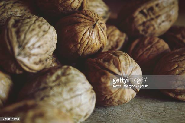 close-up of walnuts on table - nutshell stock photos and pictures