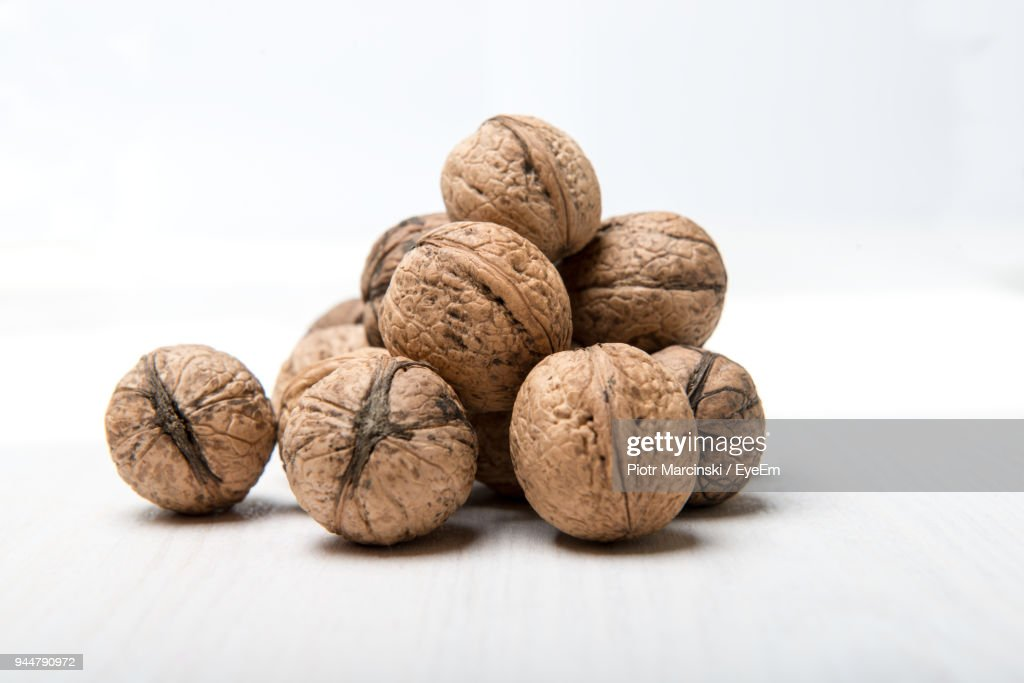 Close-Up Of Walnuts Over White Background : Stock Photo
