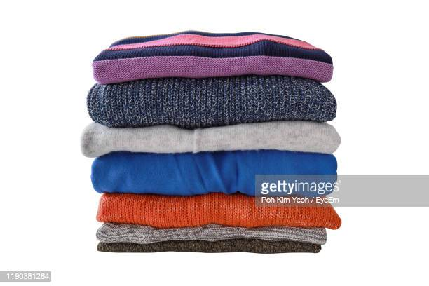 close-up of warm clothing against white background - clothing stock pictures, royalty-free photos & images