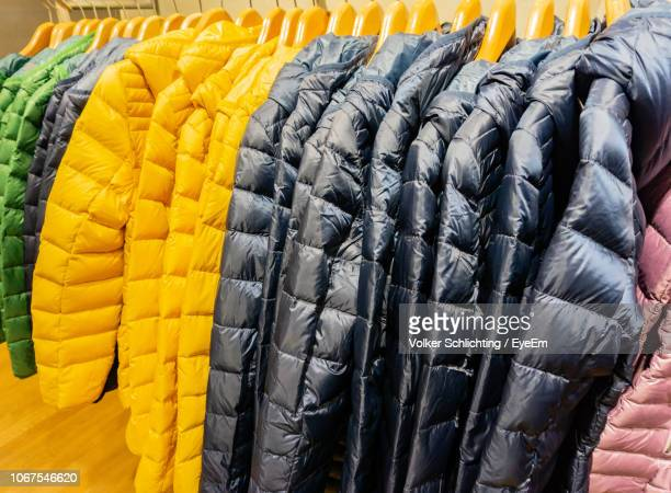 close-up of warm clothing in store - abiti pesanti foto e immagini stock